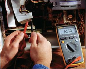 technician testing multimeters